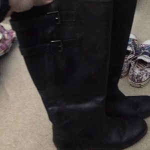 Gently worn black tall boots